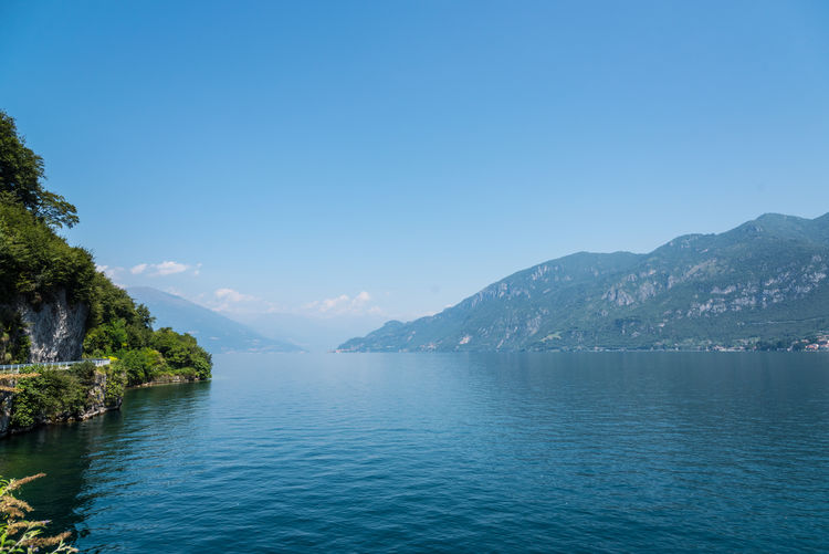 Italy Como Como Lake Lago Di Como Lago Di Como, Italy Water Sky Scenics - Nature Beauty In Nature Mountain Tranquil Scene Tranquility Waterfront Nature Blue Copy Space Idyllic No People Day Sea Non-urban Scene Tree Clear Sky Mountain Range Outdoors
