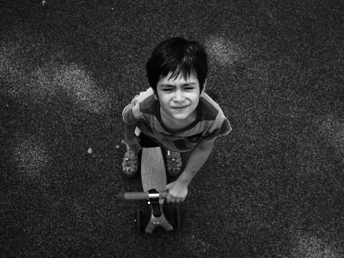 Looking at the sky Black And White Boy Cheerful Child Childhood Children Photography Day Dramatic Angles Front View Happiness Looking At Camera Looking At Camera Minimal One Person Outdoors People Portrait Portraits Real People Simple Smiling