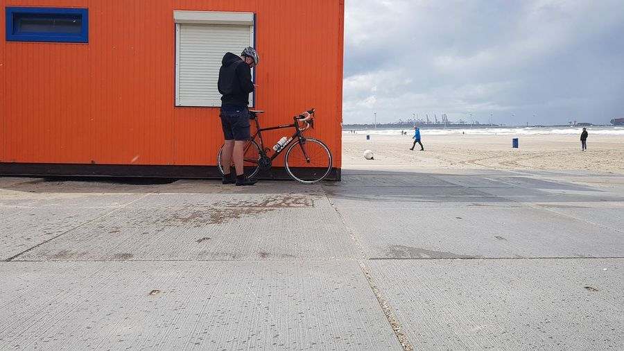 Windy Hoek van Holland Orange Bycicle Bycicle Photography Bycicle Lovers Bycicle Ride Bycicle Parking Bycicle Rider Beach Full Length Sand Men Lifeguard  Sky Architecture Cloud - Sky Beach Hut Lifeguard Hut Hut Shore
