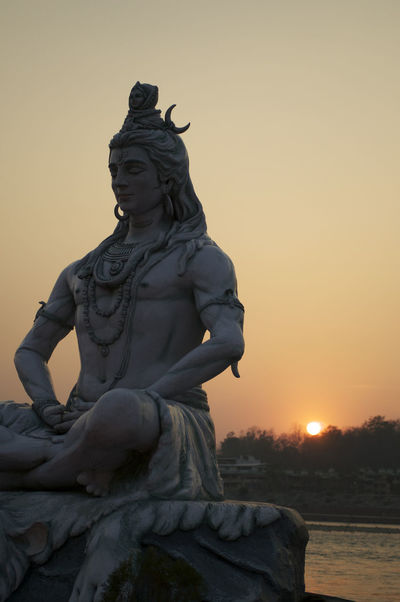 Religious statue in India Ganges River India Spiritual Place Spirituality Sunset_collection Travel Travel Photography Creativity Day Ganges Human Representation Krishna Krishnagod Male Likeness No People Outdoors Religion Religious Statues Sculpture Sky Statue Sunset Travel Destinations Travel Photos