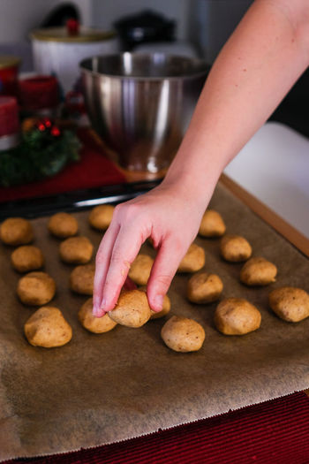 Midsection of person having cookies at home