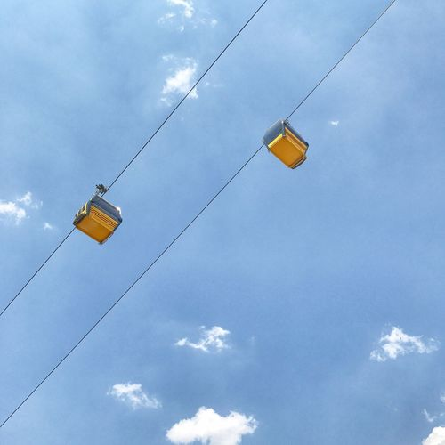 Cable Sky Cloud - Sky Transportation Electricity  Hanging Outdoors No People Yellow
