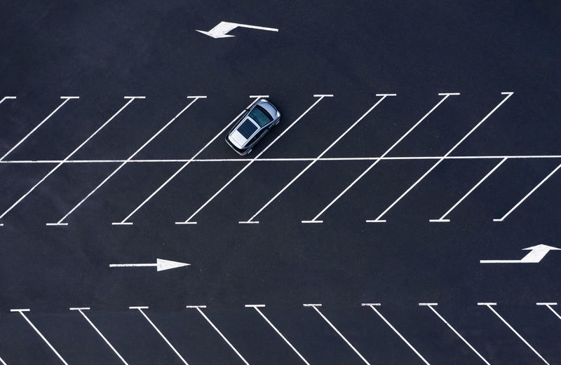 High angle view of arrow sign on road in city