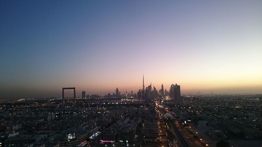 Aerial view of city buildings during sunset, dubai city