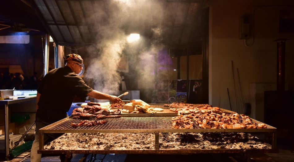 BBQ Gusti Di Frontiera Market Stall Food And Drink Food Real People Preparation  Freshness Night One Person Butcher Working People