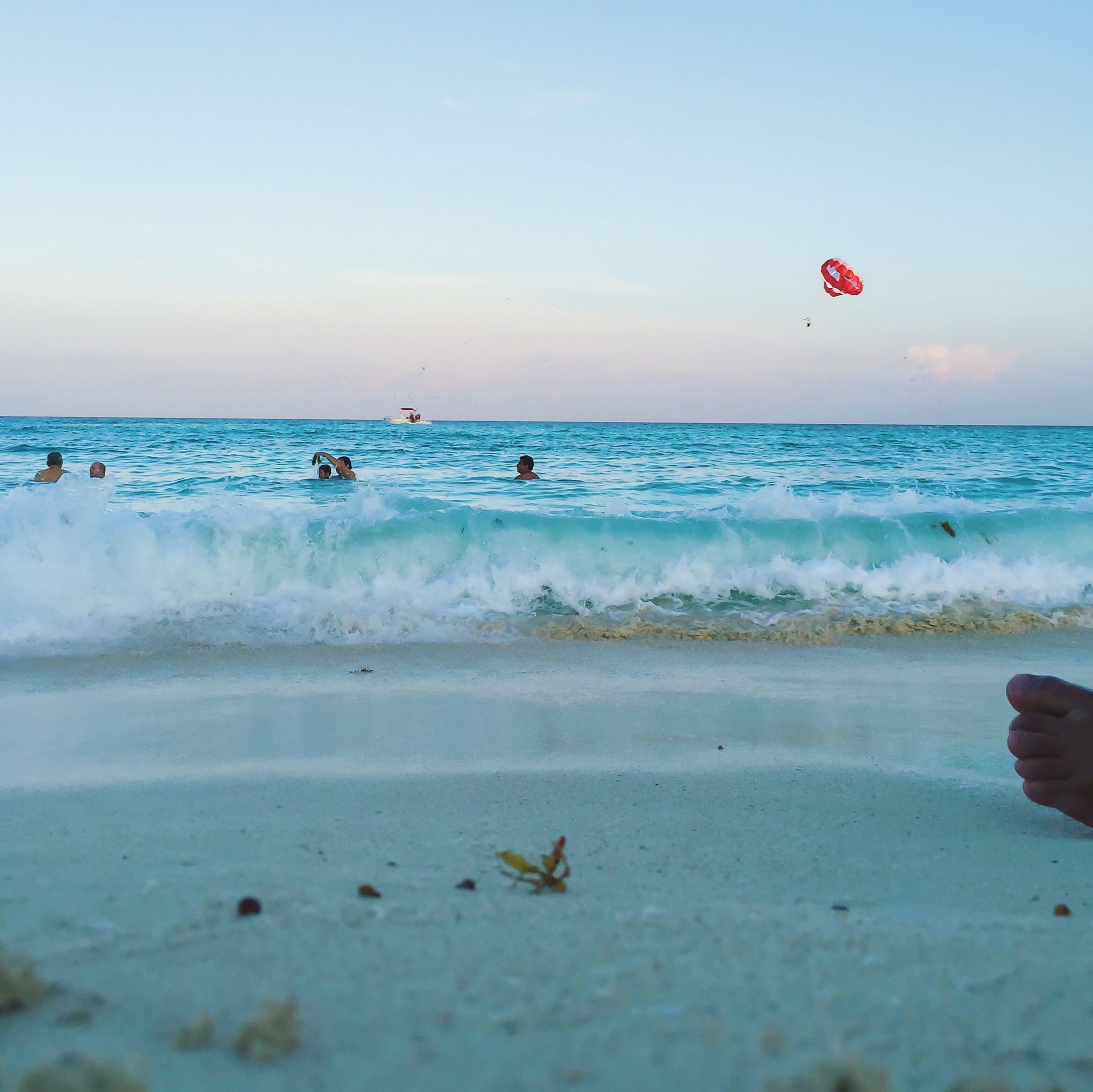 sea, horizon over water, beach, water, shore, leisure activity, sky, vacations, wave, lifestyles, sand, scenics, beauty in nature, enjoyment, flying, unrecognizable person, nature, tranquility, water sport