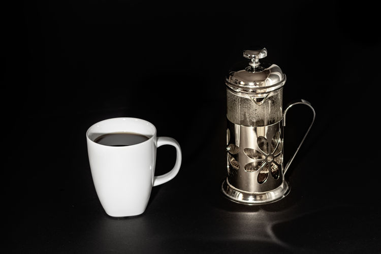 A white cup and a plunger - french press over black Food And Drink Drink Refreshment Indoors  Cup Still Life Mug Table Black Background Coffee Cup No People Studio Shot Coffee Coffee - Drink Close-up Container Jug Freshness Food Handle Pitcher - Jug Crockery Plunger French Press