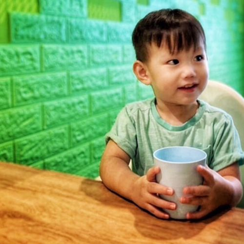 In Cafe  Childhood Drink Indoors  Males  Refreshment My Best Photo Food And Drink One Person Cup Child Sitting Drinking Table Portrait Boys Waist Up Front View Looking Holding Glass