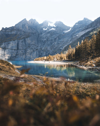 Autumn Hiking Reflection Alps Beauty In Nature Cold Temperature Day Idyllic Lake Mountain Mountain Peak Mountain Range Nature No People Oeschinensee Outdoors Plant Reflection Scenics - Nature Sky Switzerland Tranquil Scene Tranquility Tree Water