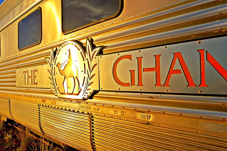 Western Script Communication No People Transportation Illuminated Retro Styled Metal Mode Of Transportation Outdoors Capital Letter Sign The Ghan Luxury Train Outback Australia Traditional Train Golden Sunlight