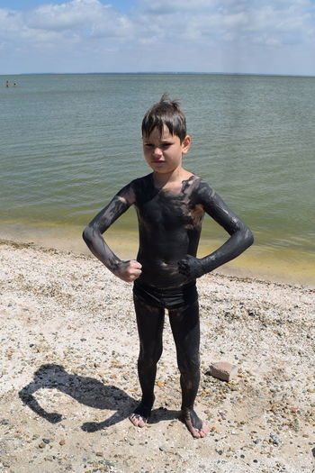 Boy Covered In Mud On  Beach