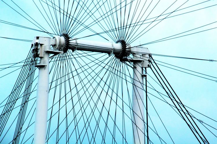 The Singapore flyer mechanical support system Cable Ferris Wheel Low Angle View Machine Part Motion Capture Outdoors Part Of Singapore Flyer Suppo Sky The Spokes