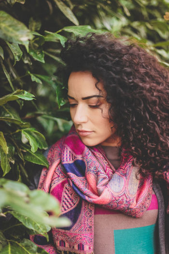 Close-Up Of Young Woman By Plants