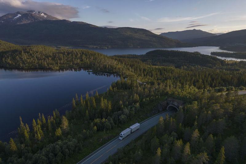 White semi truck on the scenic nordland norwegian road during midnight sun