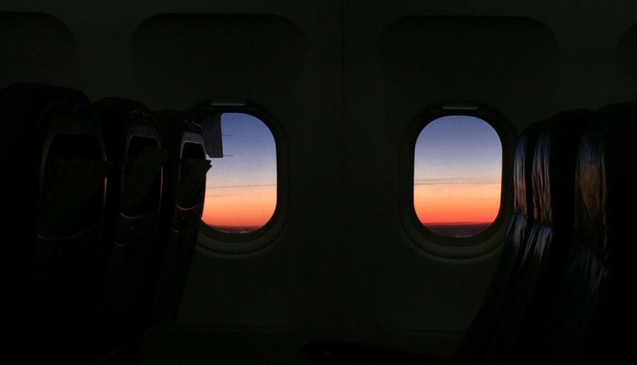 Dusk Eyes in the Emptyness - From An Airplane Window Flyswiss Aerial Shot
