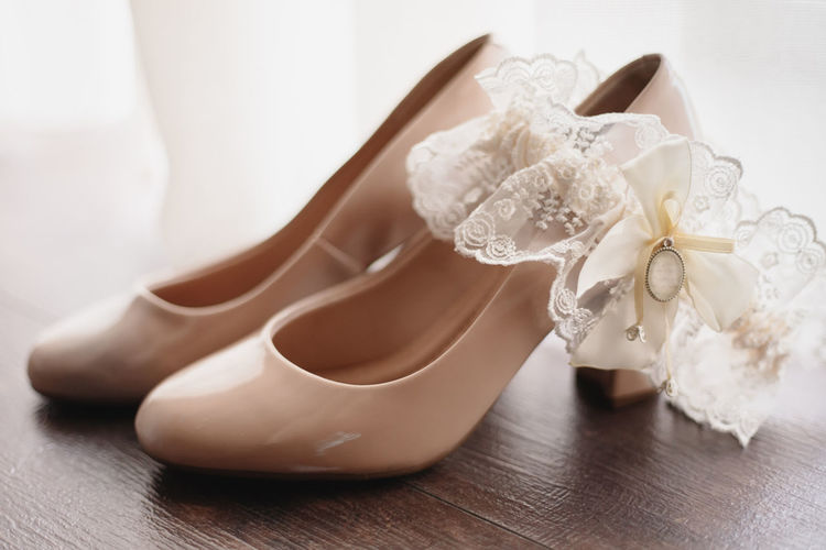 High angle view of white shoes on table