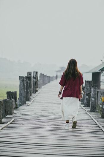 Rear view of woman walking on walkway