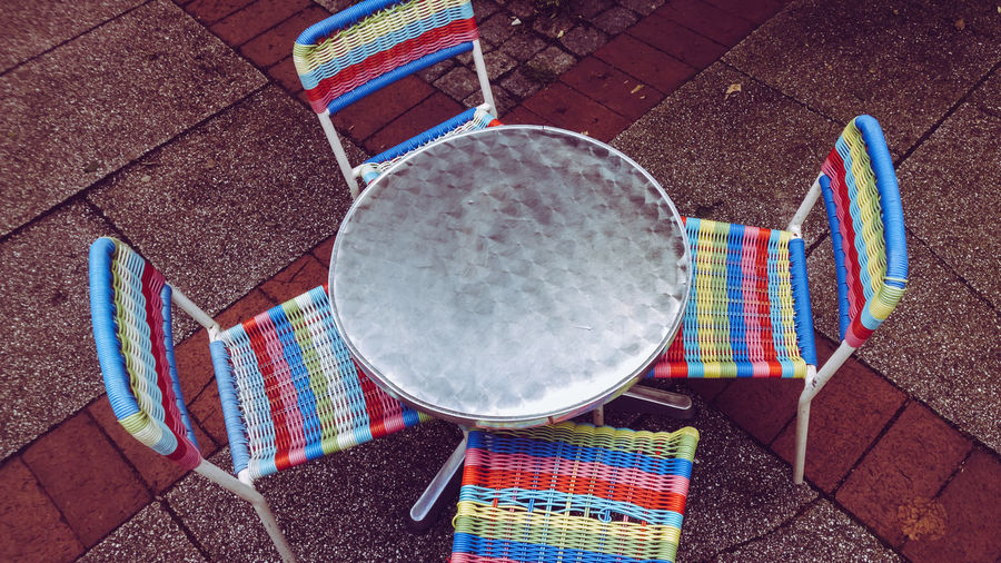 City Life Urban Lifestyle Chairs Children Only Day Group Of Objects High Angle View Multi Colored No People Outdoors Side Walk Table And Chairs