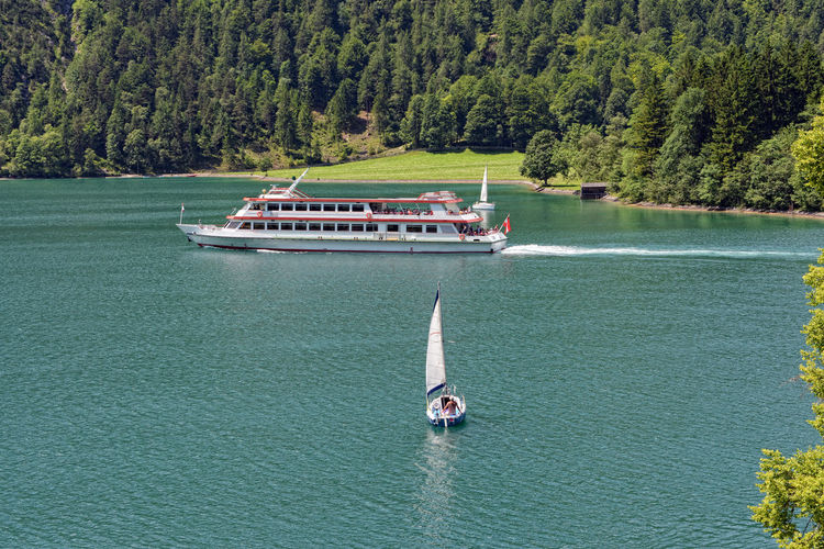 Tourist boat driving along on Achensee in Tirol / Austria. Karwendel mountains. Achensee Alps Austria Day European Alps Karwendel Lake Nature Nautical Vessel Pertisau Pertisau Am Achensee Sea Ship Tirol  Tourist Boat Trip Tranquil Scene Travel Destinations Tree Tyrol Water Österreich