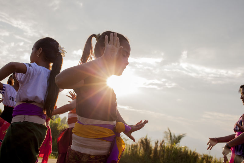 balinese dance Against The Light Bali Bali, Indonesia Balines Dance Cloud Culture Fun Girls Girls Dan Move Outdoors Sarong Sunlight Tradition Young Women
