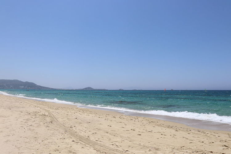 Beautiful beach view, Naxos, Greece Clear Sky Naxos Sand Beach Beach Beauty In Nature Blue Clear Sky Copy Space Day Horizon Horizon Over Water Land Motion Nature Outdoors Powerful Waves Sand Scenics - Nature Sea Sky Surfing Tranquil Scene Tranquility Turquoise Water