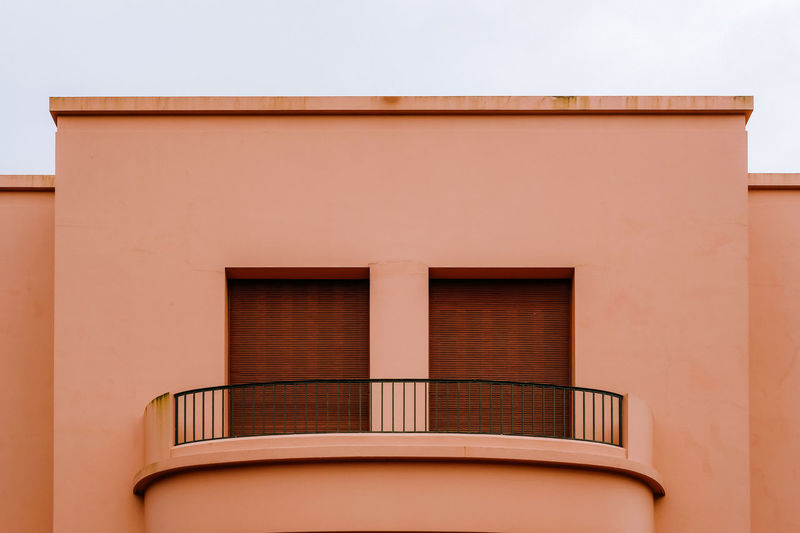 Architecture Built Structure Building Exterior No People Building Window Day Outdoors Residential District City Low Angle View Sky Orange Color Façade Nature Balcony Brown Wall - Building Feature House Modern Apartment