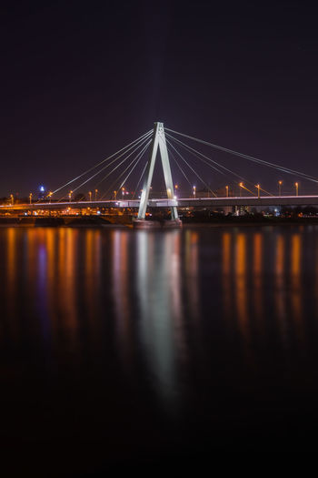 View of the illuminated Severins Bridge and the Long River Rhine at Night in Germany Cologne 2018. Cologne City Night Water River Illuminated Germany Lights Travel Destinations Tourism Severinsbrücke Severins Bridge Architecture Connection Bridge - Man Made Structure Built Structure Transportation Bridge Reflection Suspension Bridge Engineering Sky Nature Waterfront Cable-stayed Bridge Outdoors