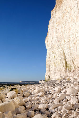 Burling Gap Chalk Cliffs Global Warming Seven Sisters Beauty In Nature Clear Sky Day Erosion Erosion At The Beach Erosion Effects Horizon Over Water Nature No People Outdoors Pebble Beach Rising Sea Levels Rock - Object Rock Formation Scenics Sea Seven Sisters Cliffs Sky Sunlight Tranquil Scene Tranquility
