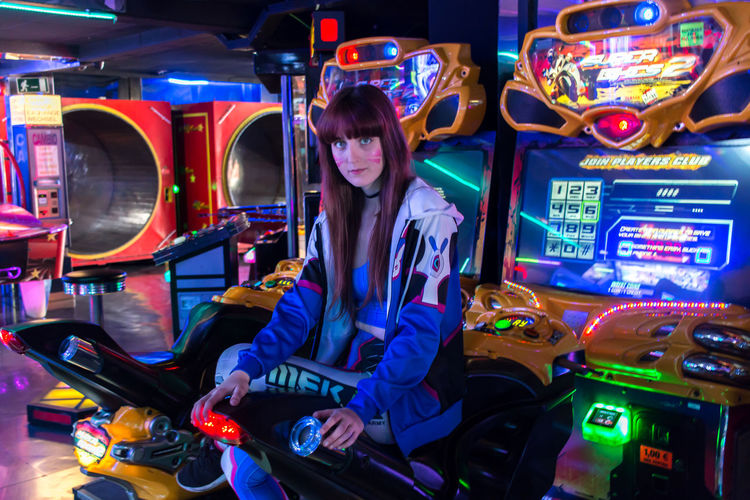 Full length of woman sitting in amusement park