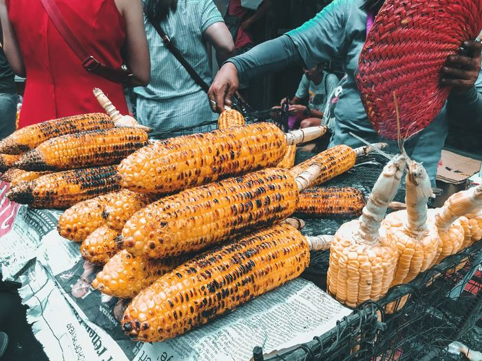 grilled corn on the sidewalk Food And Drink Food Market Freshness Market Stall Corn Wellbeing Real People Day Abundance Midsection For Sale Retail  Healthy Eating Incidental People Outdoors Men Large Group Of Objects People Small Business