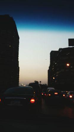 Car Transportation City Land Vehicle Traffic Mode Of Transport Illuminated Road Sky Cityscape Red Light Outdoors