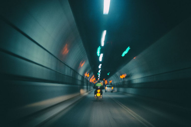 Blurred motion of illuminated greenwich tunnel in london, united kingdom