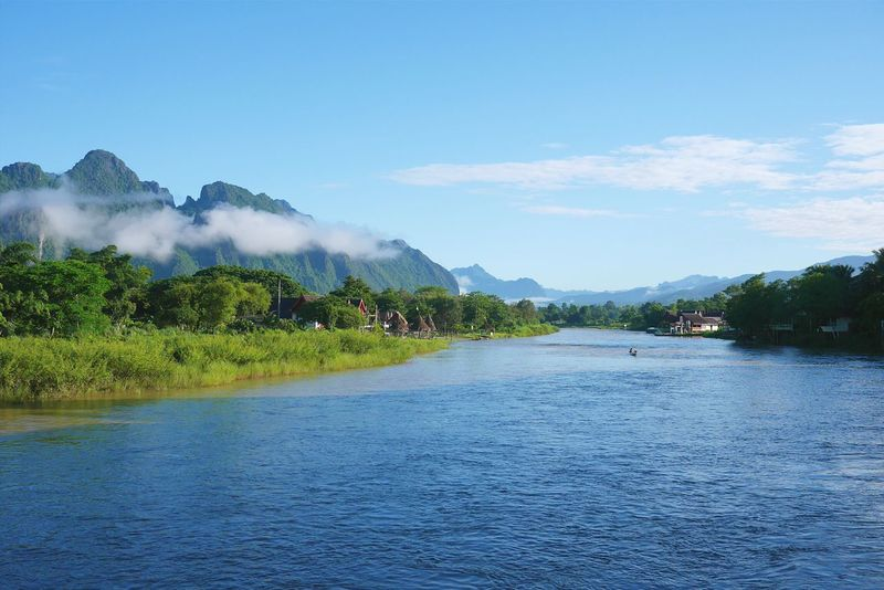 River Blue Sky Natural Mountains And Sky Wide River Laos Laos, Lao Trip