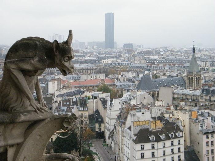 Statue Against Cityscape