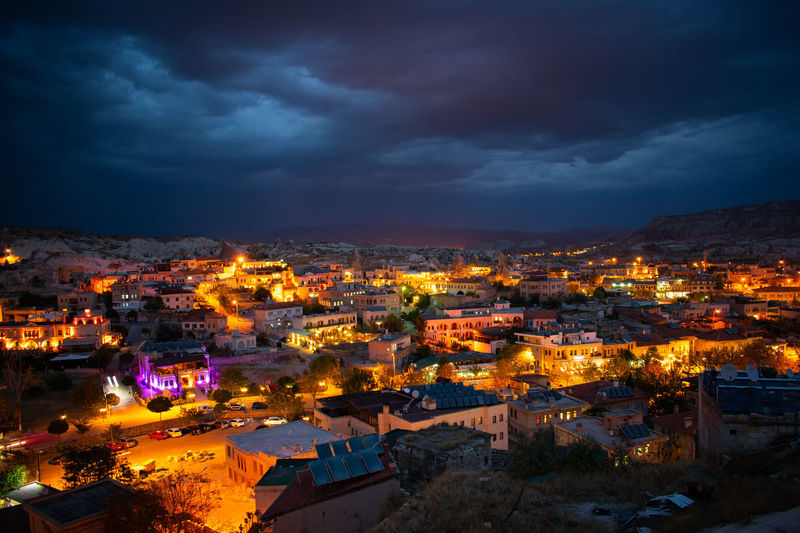 High Angle View Of Illuminated Townscape Against Sky At Night