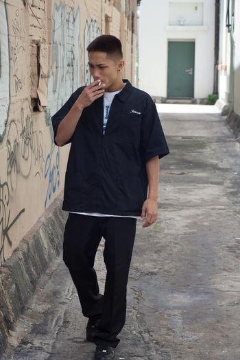 Full length of man standing outdoors