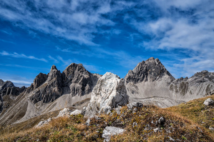 Autumn in the mountains Sky Scenics - Nature Cloud - Sky Mountain Landscape Environment Beauty In Nature Nature Mountain Range Tranquil Scene Rock Non-urban Scene Blue Rock - Object No People Tranquility Day Solid Mountain Peak Outdoors Formation Autumn Tyrol Alps Austria The Great Outdoors - 2019 EyeEm Awards