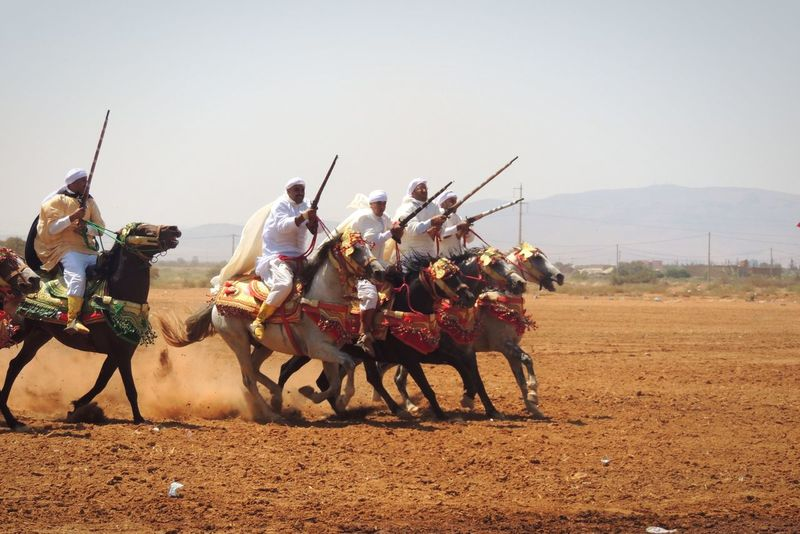 Moroccan culture Horse Domestic Animals Working Animal Cowboy Cowboy Hat Outdoors Real People Sky Mammal Day Men Gambling Horse Racing Sheriff Animal Themes Culture Tradition Welcome Weekly Connected By Travel