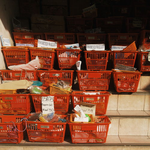 Objects In Red Crates Arranged On Steps For Sale