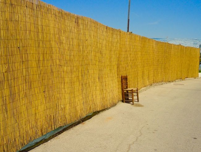 Albufera Architecture Beauty In Nature Building Exterior Built Structure Chair Clear Sky Day Gone Hot Lonely Nature No People Outdoors Shadow Sky Summer Sunlight The Way Forward Yellow Paint The Town Yellow