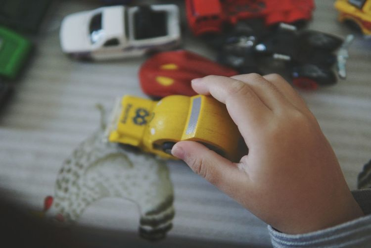 baby boy's playing with toy car Kidsphotography Kids Playing Holding Toy Car Toy About A Boy Toys EyeEm Gallery EyeEm Selects Human Hand Human Body Part One Person Indoors  People Business Finance And Industry Adult Close-up Lifestyles