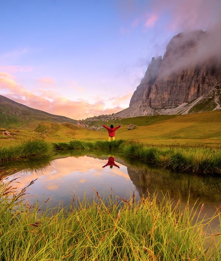 || I want to break free || Reflection Water Lake Landscape Mountain Cloud - SkyColors Travel Destinations Wilderness Sunrise Dawn Tranquility Dolomites, Italy Veneto Italy Mondeval Outdoors Sky Red One Person Rural Scene Nature Scenics Beauty In Nature Day