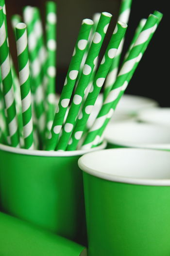 Green Party Straws and Cups Birthday Party Close-up Cup Drink Empty Green Green Color Indoors  No People Paper Party Time Pattern Refreshment Selective Focus Still Life Straws Table