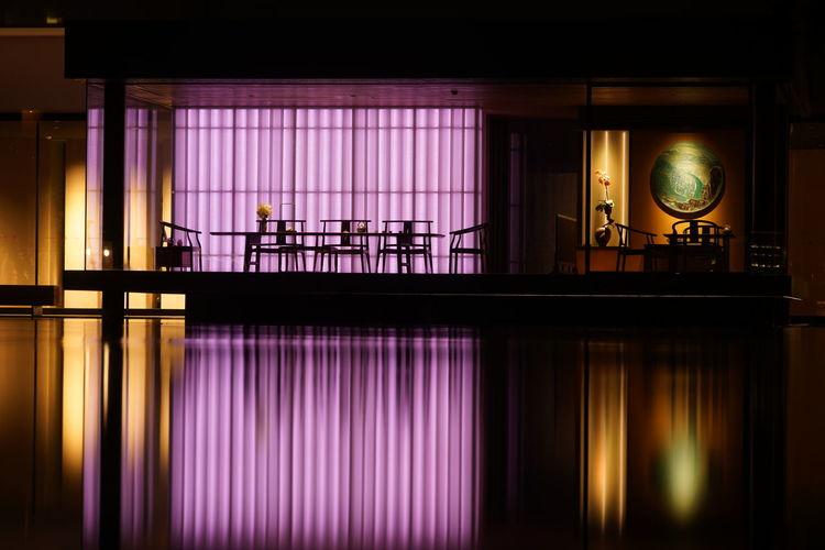 Reflection of illuminated lights on glass
