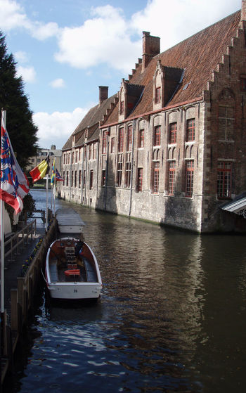 Architecture Blue Sky Boat Bruges Brugge Canal Clouds Europe Flags Landscape Narrow Nature Outdoors Reflection Shadows Sky Travel Tree Vertical Water Waterway