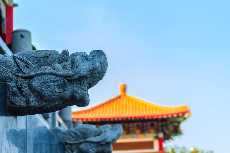 Beautiful Chinese Dragon bibcock stone in front of Wat Leng Noei Yi Chinese temple, Thailand Chinese Temple Ancient Architecture Drain Mahayana Buddhist Temple Mahayana Temple Nonthaburi Wat Leng Noei Yi 2 Architecture Bibcock Blue Chinese Dragon Chinese Temple Chinese Temple Decoration Clear Sky Close-up Day Drainage Channel Focus On Foreground Low Angle View Mahayana No People Outdoors Place Of Worship Religion Sculpture Sky Statue Stone Sculpture Stone Statue