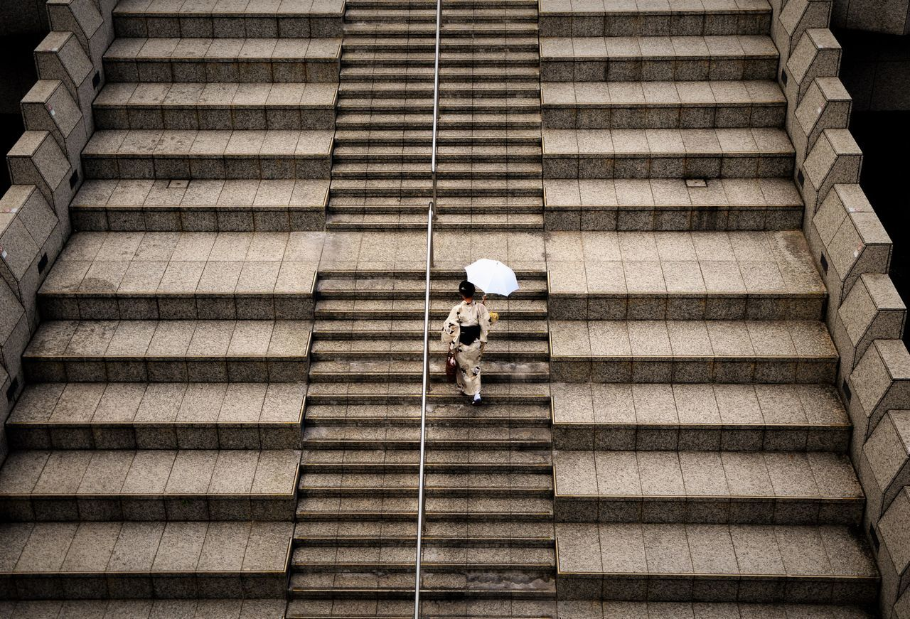 High angle view of woman walking on steps