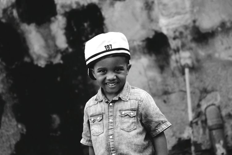 EyeEm Best Shots Eye4photography  EyeEmBestPics EyeEm Best Shots - Black + White Blackandwhite Black And White The Week on EyeEm EyeEm Gallery Somewhere In Dar Es Salaam Model Posing For The Camera Potrait Headwear Child Portrait Smiling Childhood Males  Boys Happiness Looking At Camera Front View