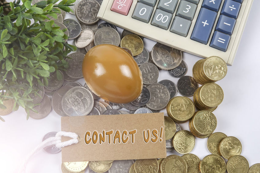 SAVING CONCEPT WITH COINS AND GOLDEN EGG ON WHITE Planning Business Conceptual Business Finance And Industry Calculator Coins On The Table Dividend Education Saving Egg Expenses Financial Profit Return On Investment Saving Saving Concept Tag Top View