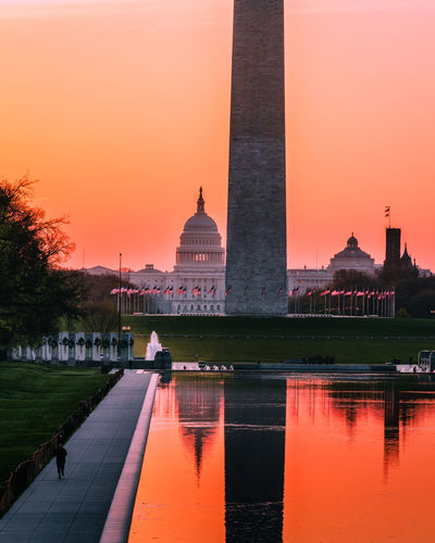 Sunrise over the National Mall in Washington, DC Architectural Column Architecture National Mall National Mall, Washington, DC Politics And Government Reflecting Pool Sunrise Sunset Tourism Tourism Destination Travel Travel Destinations US Capitol Building Vacations Washington Monument Washington, D. C. Water